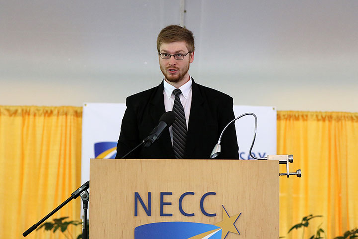 A male student at the podium during commencement