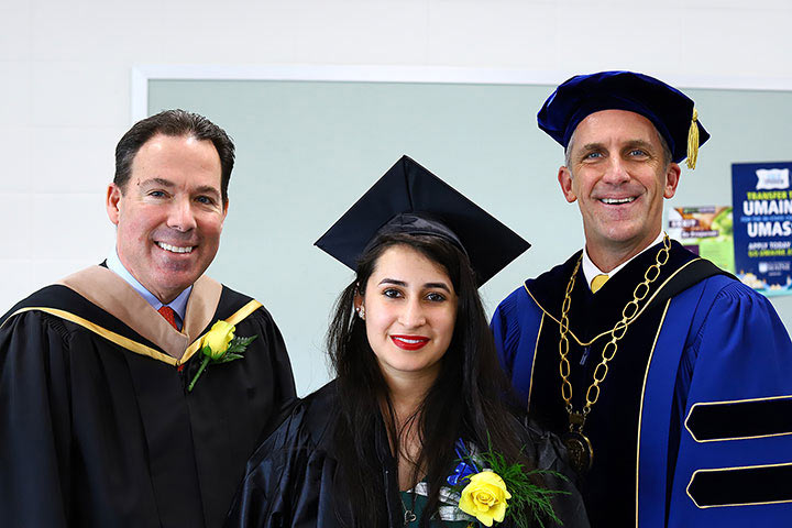 President Lane Glenn with the Student Commencement speaker Hechavarria, and Featured Commencement Speaker, Rivers.