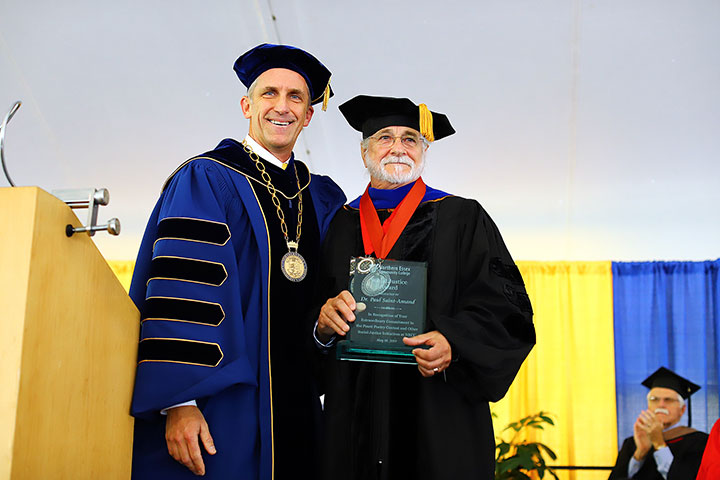President Lane Glenn with retired professor English Paul Saint-Amand, who is holding and award