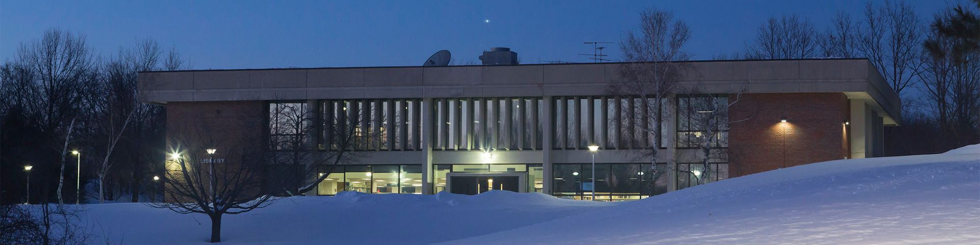 NECC Library pictured at night, buried in the snow