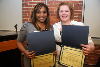 Anais Chiclana and Kristin Morrell proudly display their diplomas from the COMPASS Community College Collaborative