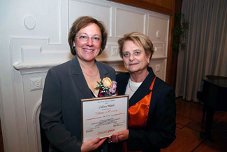 NECC employee Colleen Walsh accepts Tribute to Woman plaque from Rebecca Hall, executive director of the Lawrence YWCA