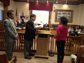 Eva Caraballo, '12, was recognized by the Lawrence City Council
