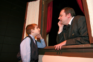 "Max Howard of North Andover plays Boy In Street and Mark Morrison of Georgetown plays Scrooge in Northern Essex Community College's adaptation of the Charles Dickens classic ""A Christmas Carol"" ."