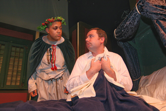 "Adrian Peguero of Lawrence plays Christmas Present and Mark Morrison of Georgetown plays Scrooge in Northern Essex Community College's adaptation of the Charles dickens classic, ""A Christmas Carol"""