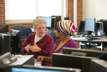 Linda Murphy instructs an NECC student in the Riverwalk computer math lab