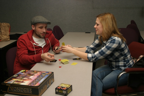 Steven Edwards and Angela Bowie playing a board game at an NECC Bacon Board Gamers event.