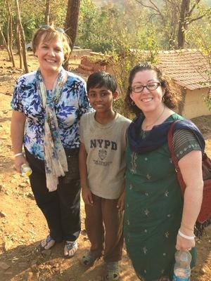 Cheryl Goodwin and Dina Brown with Vinod patil, a student at the Kalkeri Sangeet Vidyali School.