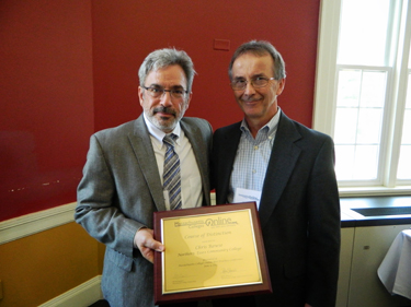 Michael Badolato, of Newton, NH, dean of Academic Technology at North Shore Community College (NSCC) in Danvers, presents the Course of Distinction to Chris Rowse