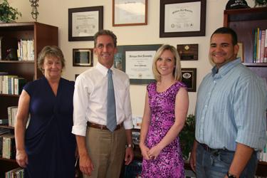 Linda Fagan, President Lane Glenn, Perry Lara, and Daniel Rivera.
