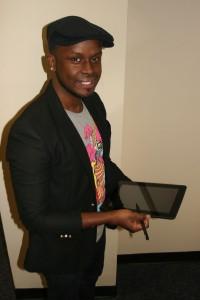 T-shirt design winner Angel Augusto of Lawrence.
