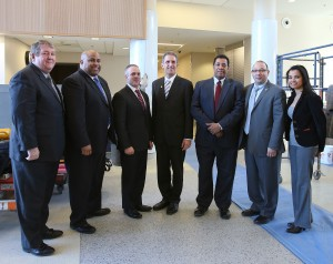 Bill Moynihan, chair of the NECC Board of Trustees, Lawrence Mayor Dan Rivera, MA Secretary of Education Matthew Malone, NECC President Lane Glenn, State Representative Marcos Devers, State Representative Frank Moran, and Lawrence City Councilor Oneida Aquino.