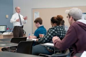 Paul Cavan, coordinator of the Criminal Justice Program, teaching his class.