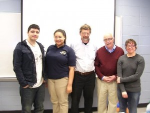 """--- Northern Essex Community College hosted a panel discussion March 12 on """"Genocide in Our Time."""" Taking part were, from left, Nik Arboleda, president, Contemporary Affairs Club, which sponsored the event; student Nairoby Sanchez, representing Rwanda; Dr. Stephen Russell, instructor and moderator; Gazette columnist Tom Vartabedian, representing Armenia, and Dr. Ivy Helman, Merrimack College instructor, who discussed the Jewish Holocaust."""