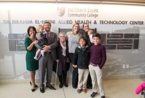 The El-Hefni family standing in front of the wall honoring Dr. Ibrahim El-Hefni.