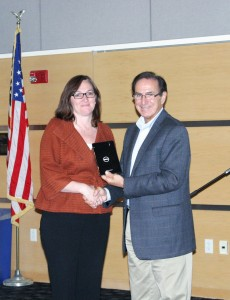 Kymberly Codair, who waschosen as the college's top entrepreneurial student, receiving her Dell tablet from Bill Zannini