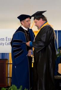 NECC President Lane Glenn presented Human Services graduate Bruce Augustonovich with his diploma.