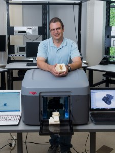 Professor Jim Cahaly shows off the college's new 3D printer
