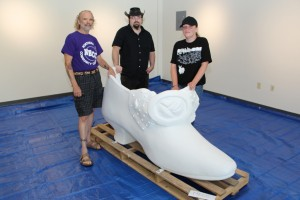 NECC art professor Marc Mannheimer with art students Adam Dorgan of Peabody and Jaclyn Marr of Salisbury stand with the blank shoe before they set to work creating an NECC specific design.