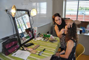 """Makeup artist Rose Westerman prepares an extra for her role in the German film """"Forget Me Not"""". A few scenes were filmed at NECC."""