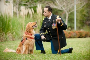 Former U.S. Army Captain Luis Carlos Montalván and his service dog Tuesday