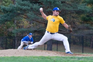 Ryan Decker of Salem, NH, an NECC sophomore majoring in liberal arts threw a pitch during the NECC Alumni Day Game.
