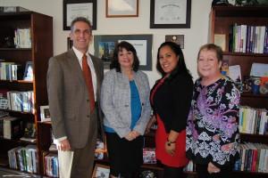 NECC President Lane Glenn with employee recognition award winners Julie Carey, Ingrid Polanco, and Maria Hom.