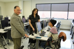 Mike Hearn, director of library services, Jenny Fielding, coordinator of library services, Lawrence, and NECC education major Jaritza Hildalgo of Lawrence in the college's new information literacy lab.