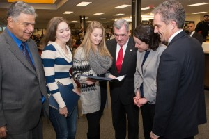 Haverhill Mayor James Fiorentini, Early College Graduates Kayleigh Bergh and Jocelyn Dubois, Haverhill Superintendent James Scully, State Senator Kathleen O'Connor Ives, and NECC President Lane Glenn.