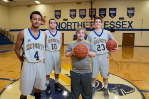 Brett Hanley (center) with NECC Knights basketball players Bryon Centeno of Lawrence, Matt Jameson of Haverhill, and Matthew Lynch of Plaistow.