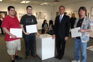 2015 NECC Student Art Show Winners (L to R) third prize winner Julian Cruz, President's Purchase Prize winner Ryan Silva, NECC President Lane Glenn, and Honorable Mention winner Frank Hawkes.