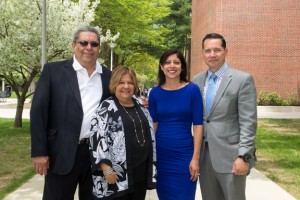 Left to right, Helen Ubiñas's parents, Maria and Sixto Ubinas, Helen, and her husband Michael Dunne, a 1991 graduate of NECC.