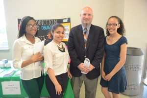 Lawrence Superintendent Jeff Riley with students (left to right) Wildaly Santana, Aysha Polanco, and Anabeliz Brito.