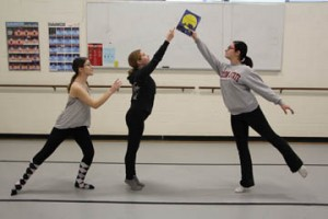 "NECC dance students Katie Formosi of Groveland, Marissa Gagnon of Salem, NH, and Alyssa Foden of Methuen prepare their student choreographed pience ""Moments"" based n the children's book ""The Kissing Hand""."