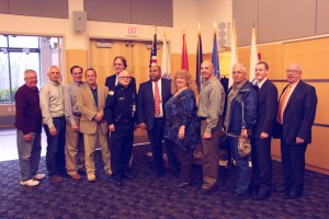 Shown left to right: NECC faculty, staff and student veterans: Al Hitchcock, staff,; Dave McCaskill, staff; Bill Zannini, faculty; Rich Sommers, staff; Jeff Linehan, chair of the NECC Board of Trustees, Dan Tirone, staff; Lawrence Mayor Dan Rivera; Shar Wolf, staff, Samson Racioppi, student; John Washington, student, John Caswell, student, and Bill Cox of the board of trustees.