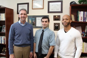 NECC President Lane Glenn with fourth quarter employee recognition award recipients Jason DeCosta and Victor DeJesus.