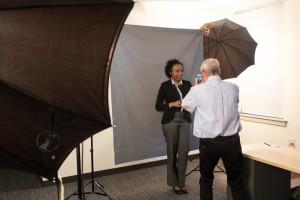 Jessica Castillo (NECC student) gets her LinkedIn portrait taken by Professor Lance Hidy.