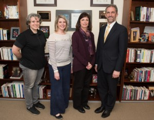 NECC faculty and staff members Anne Eshbaugh, Elle Yarborough, and Judith Pollock-Ciampi wee congratulated by NECC President Lane Glenn on receiving the quarterly NECC Employee Recognition Award.