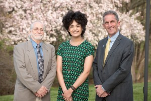NECC English Professor Paul Saint-Amand, founder of the Peace Poetry Contest Reading, with former student diannely Antigua, who was the guest speaker at the Friday night event, and NECC President Lane Glenn.
