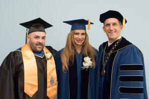 NECC student speaker Ray Florent, guest commencement speaker Attorney Wendy Estrella, and NECC President Lane Glenn.