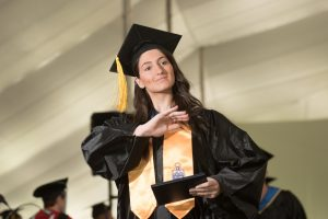 NECC graduate Taylor Langlois waves to family after receiving her dipoma.