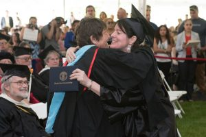Emeritus recipient Linda Desjardins, English faculty member, hugs Kim Whiting, who received her Associate in Arts: Journalism/Communication Option.