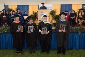 Catherine Dabrowski, Linda Desjardins, Alan Hislop, Susan Sanders, and Nancy Nickerson (not in photo) received emeritus awards during NECC's graduation ceremony.