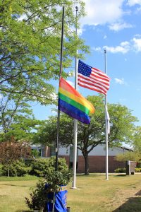 The Pride Flag was flown beside the American Flag on Thursday, June 23, as NECC paused for a moment of silence for the Orlando shooting victims.