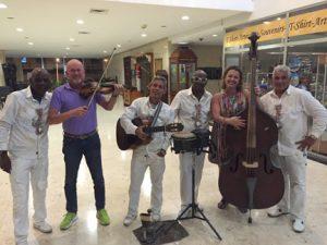 Professor Ligia Domenech hams it up with street musicians in Cuba.