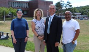 The recipients of the third quarter Employee Recognition Award were recently photographed with NECC President Lane Glenn include Adrianna Holden-Gouveia, Sharon McDermot, and Ramon Suero.
