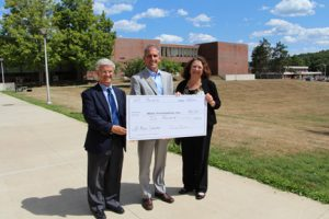 Attorney Jay Cleary, President of the Board of Trustees at HC Media and Darlene Beal, executive director of HC Media, present NECC President Lane Glenn with a check for journalism/communication scholarships.