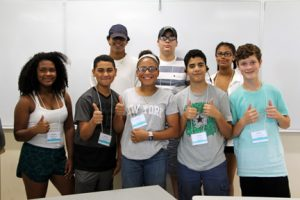 The Microscopes - campers in Engineering Professor Paul Chanley's class give a thumb's up at the end of their day at Technology Camp.