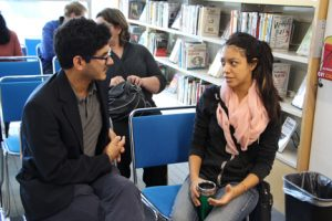 Mati Amin, takes time to discuss SOLA with an NECC student.