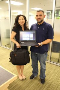 NECC librarians Susan Leonardi and Fred Curty display one of the Dell laptops and carry case available to NECC students through a new laptop lending program.